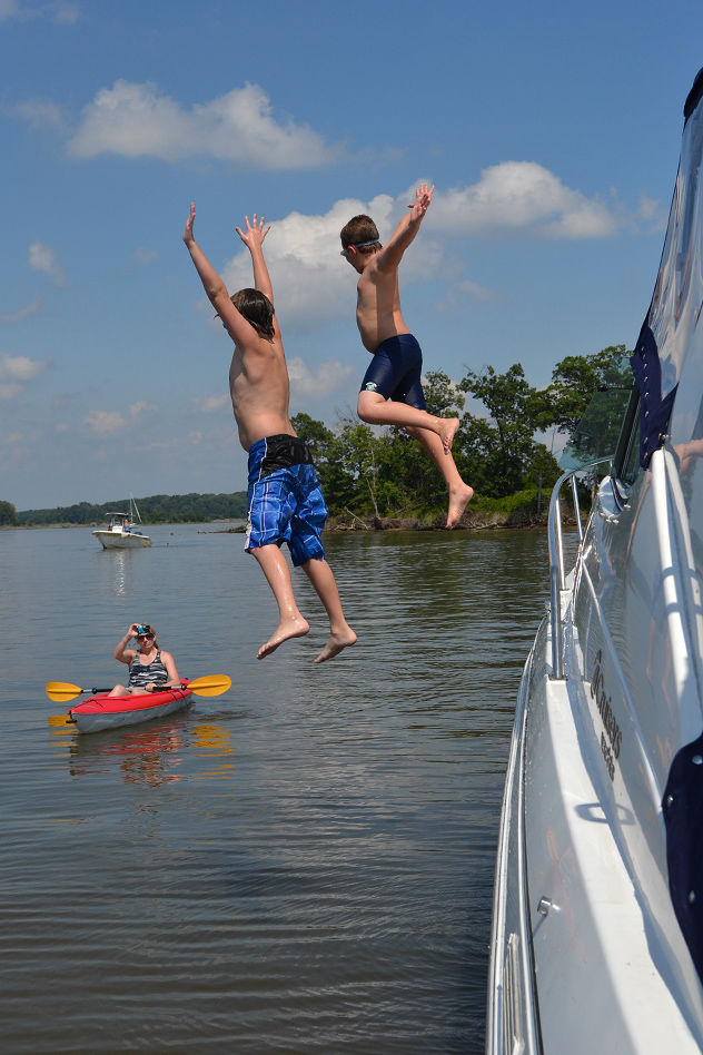 The boys jumping off Christina's bow, as the Armiral pilots her own vessel, 26JUL14
