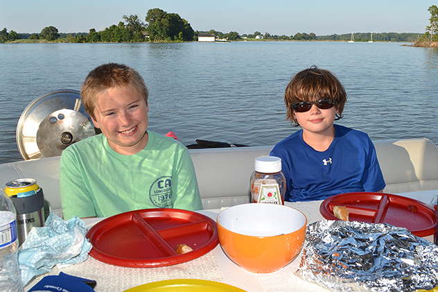 The First Mate and his buddy enjoying dinner out on the water, pretty-much a perfect day aboard the Rose!