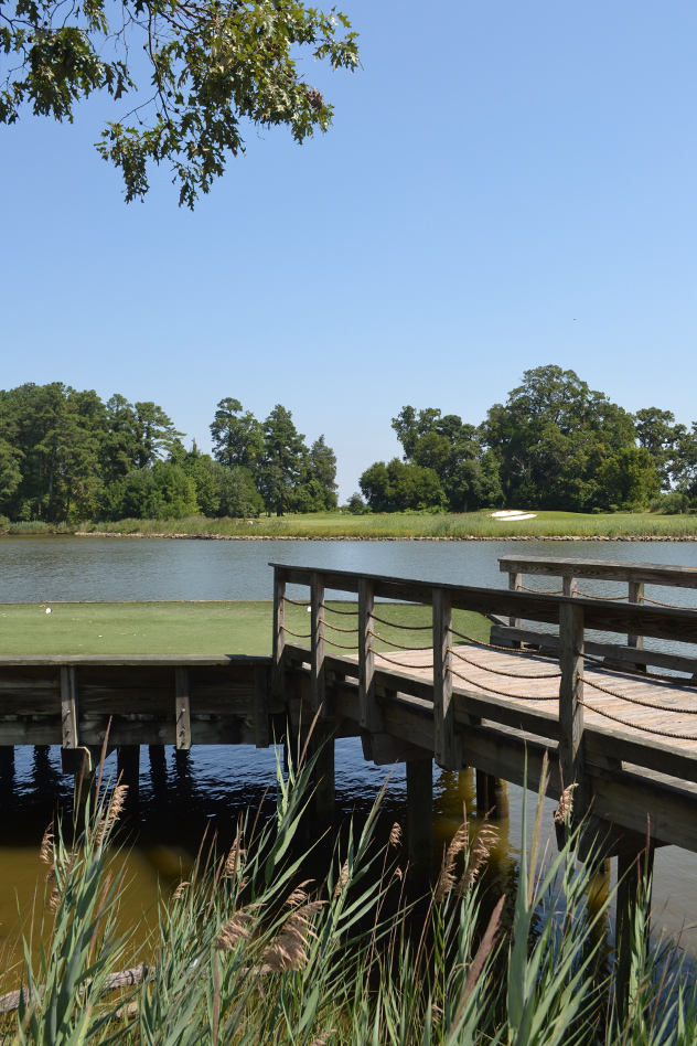 The tee-box for the River Marsh's 17th hole are elevated over the water.  The Captain was right on the pin both days!  04AUG15